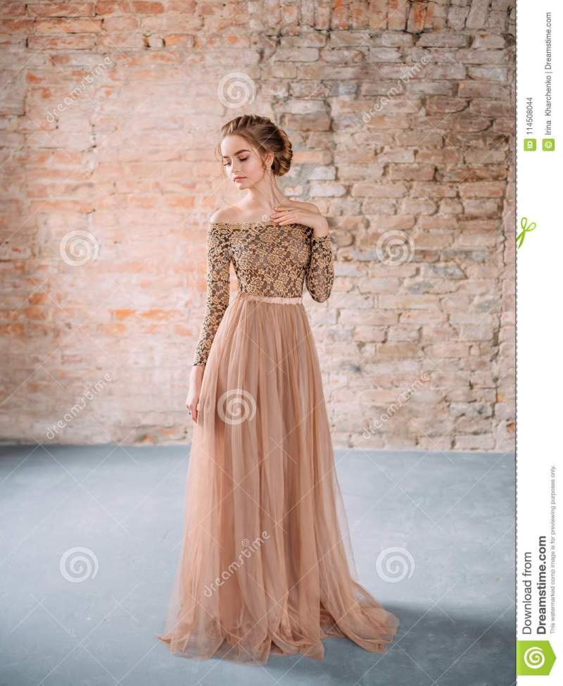 Posing In A Soft Sandy Brown Dress