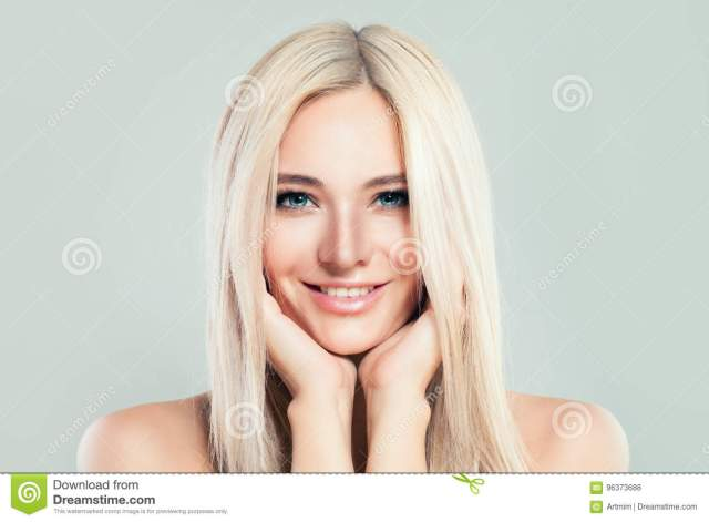 blonde model woman with healthy skin and blonde hairstyle