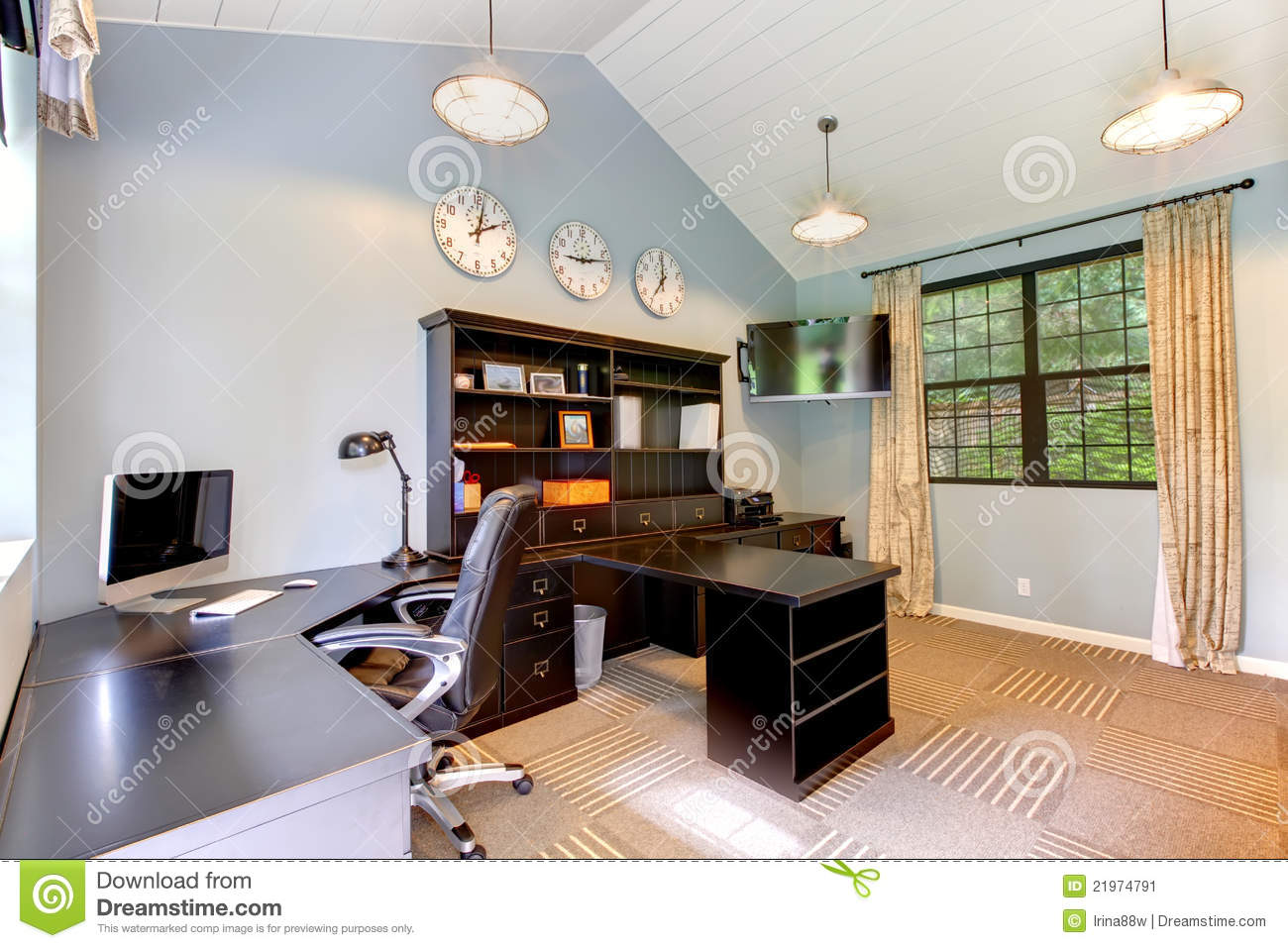 Blue Modern Home Office With Dark Brown Furniture Stock