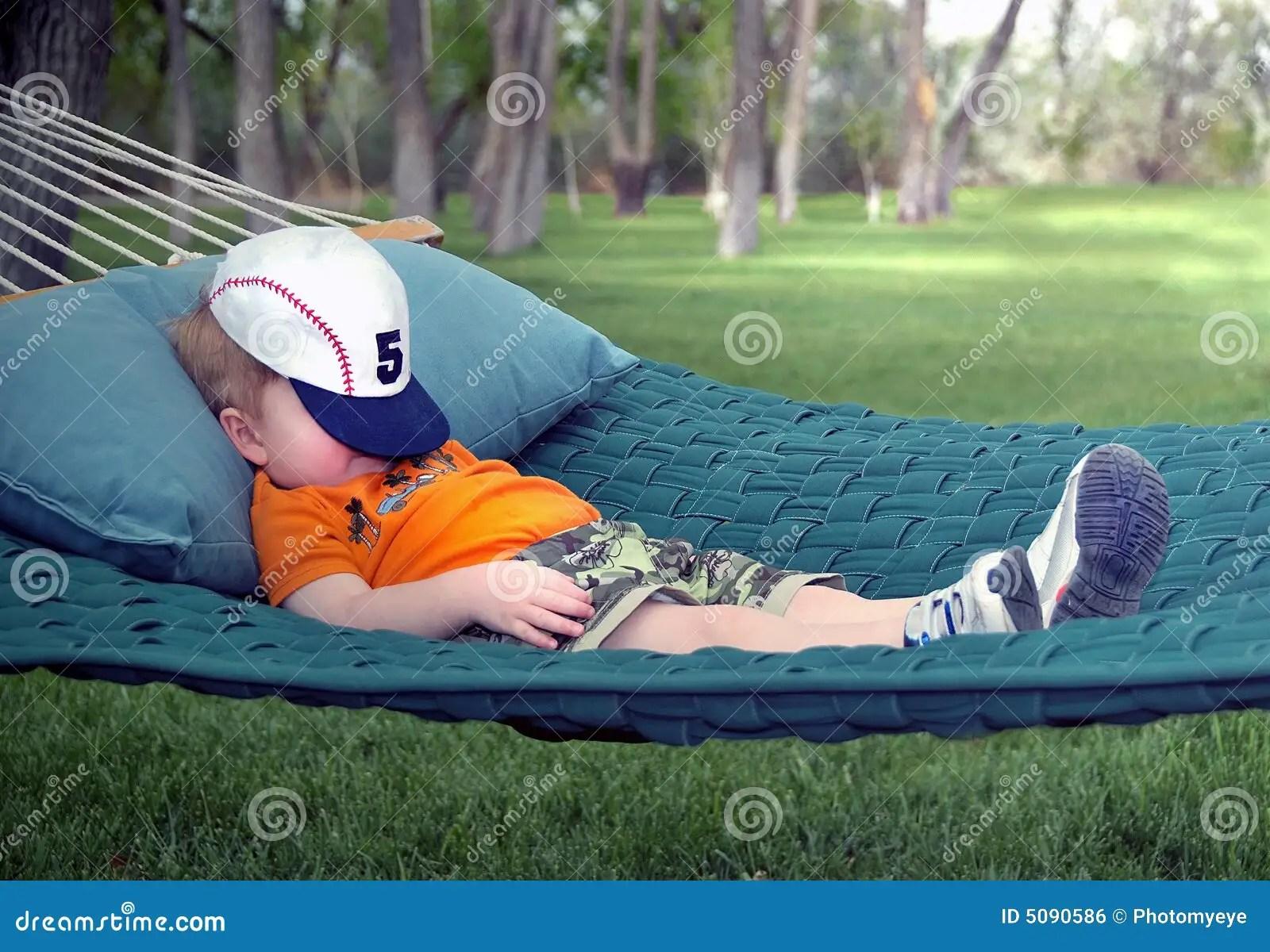 Boy Sleeping In Hammock Royalty Free Stock Image