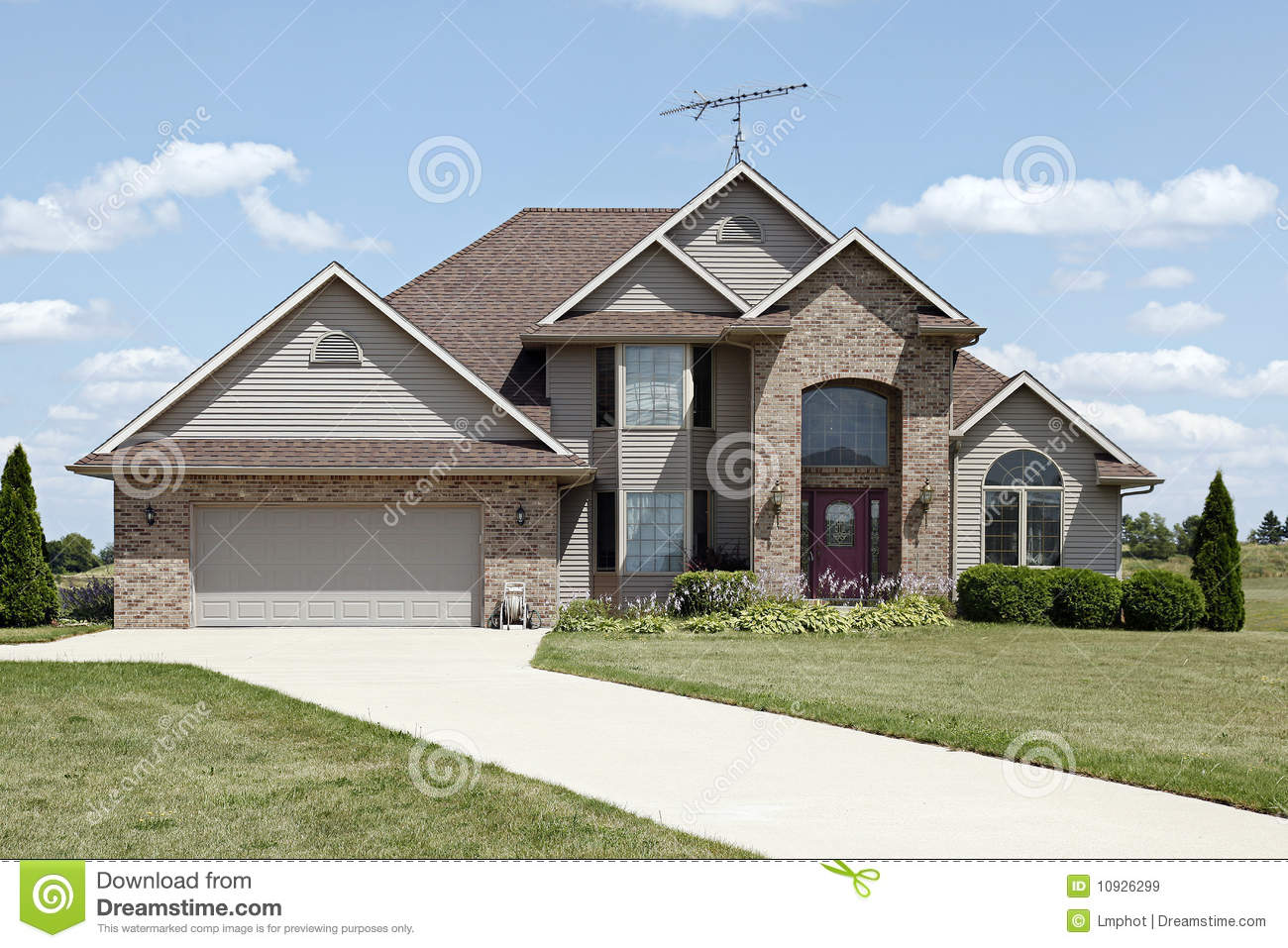 Brick Home With Arched Entryway Royalty Free Stock Images