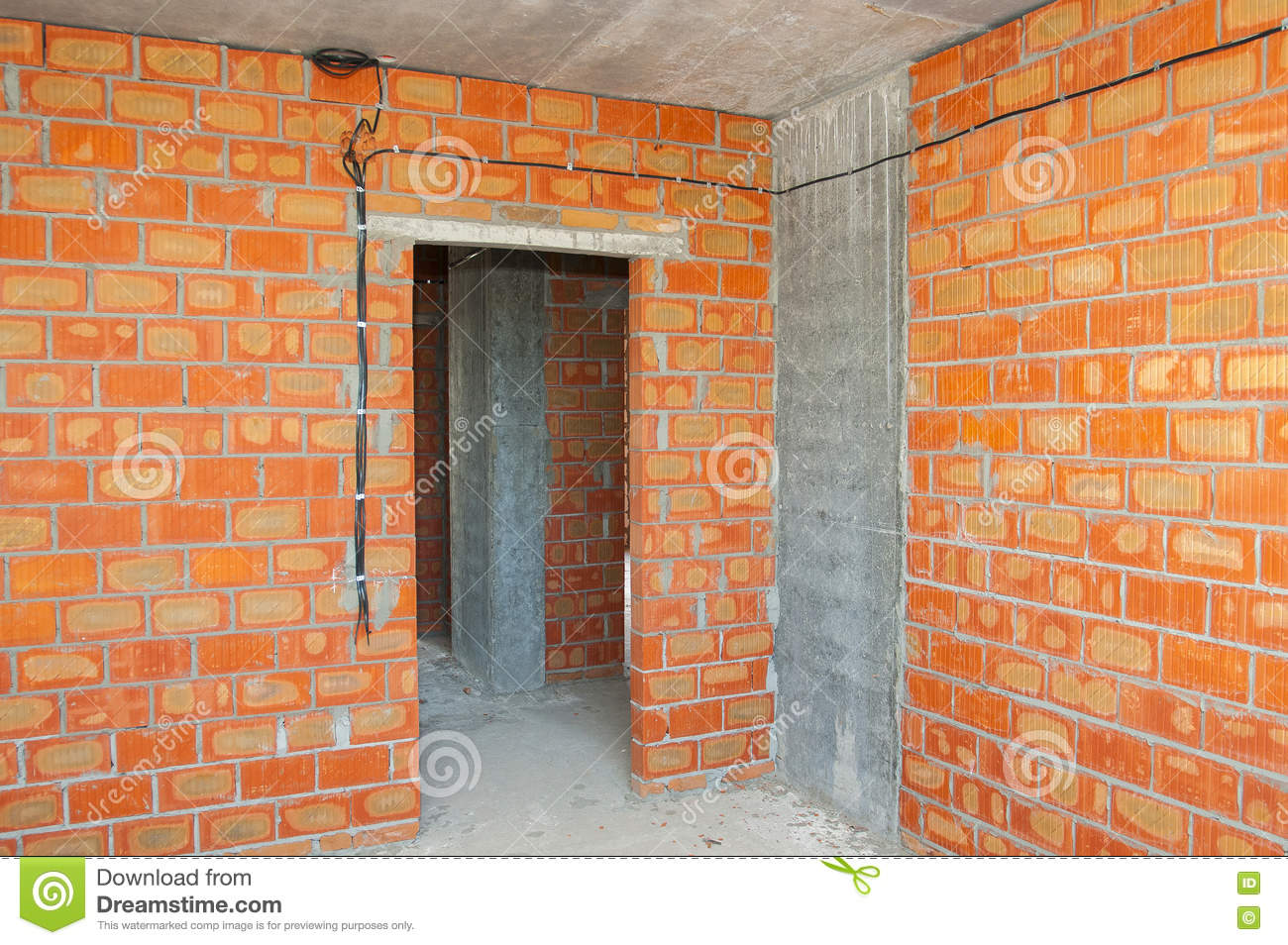 Bricklayer Building New House With Brick Walls, Interior