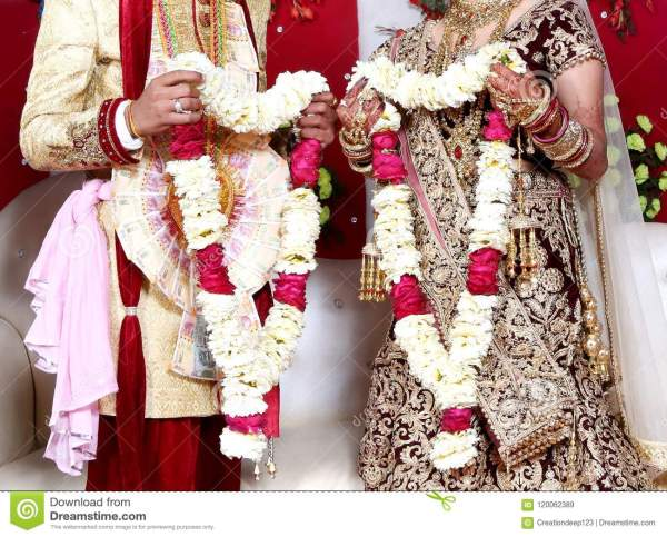The Bride And Groom At The Indian Wedding Garlands Stock
