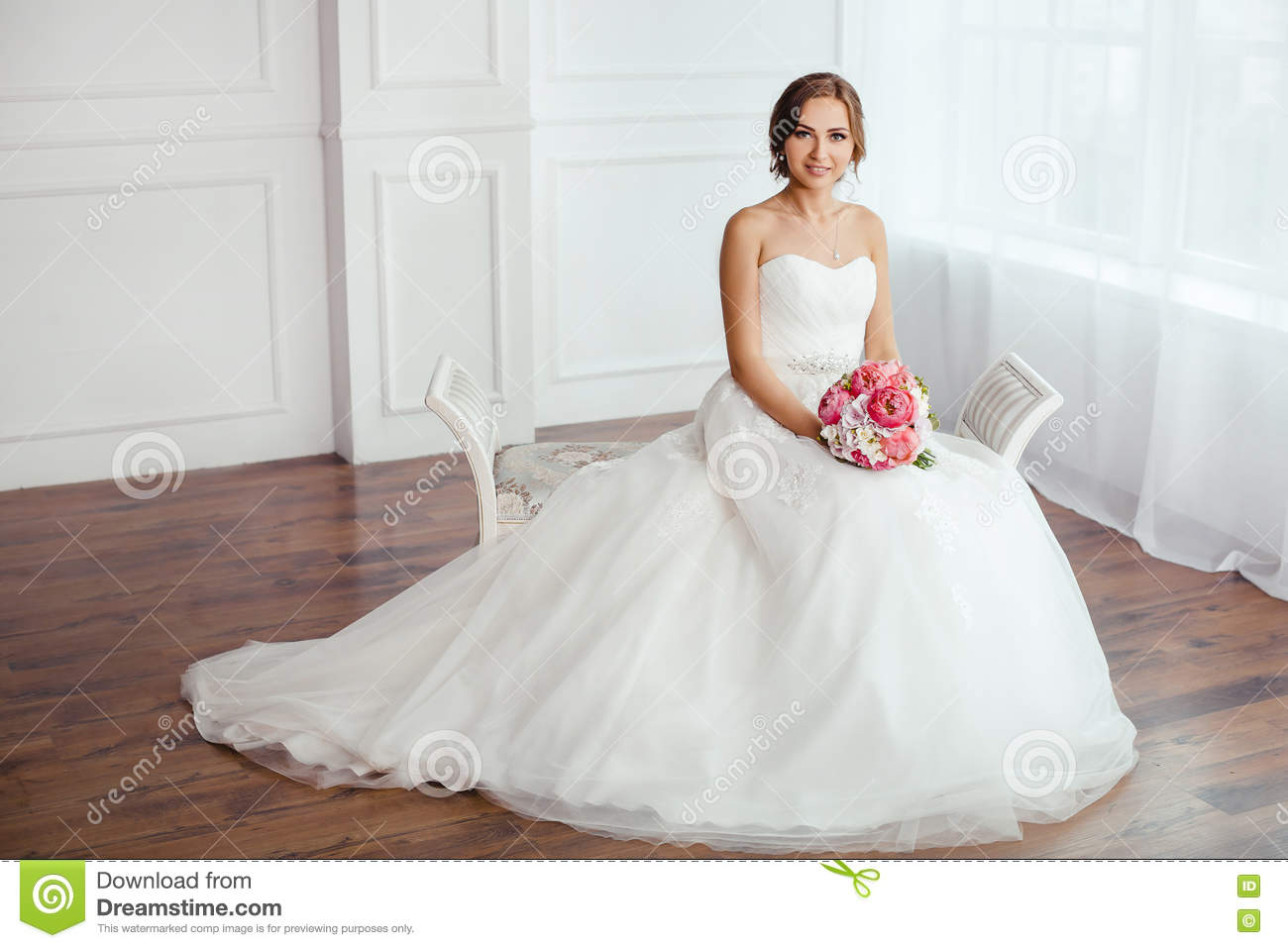 The Bride. Young Women With Wedding Dress In Very Bright