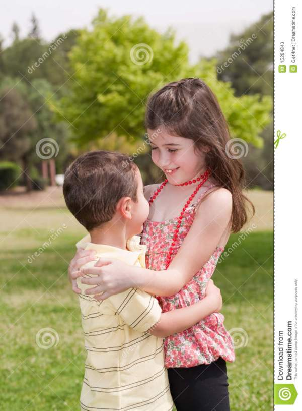 Brother And Sister Affectionatly Hugging Stock Photo ...