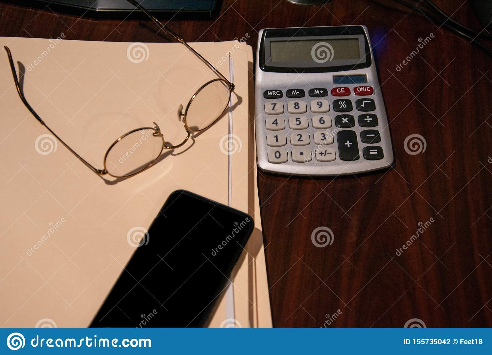 Brown Wooden Desk With Several Closed File Folders A