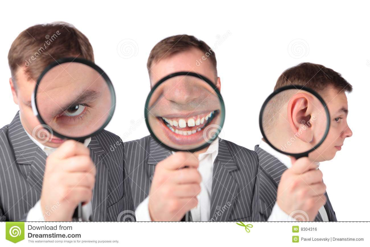 Businesspeople With Magnifier On Ear Eye Mouth Stock