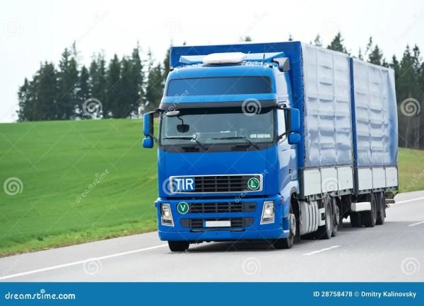 Camion Bleu Avec La Remorque Au-dessus Du Ciel Bleu Photo ...