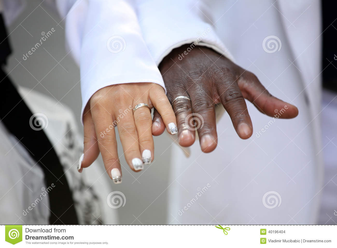 Causian And African American Couple Holding Hand Stock