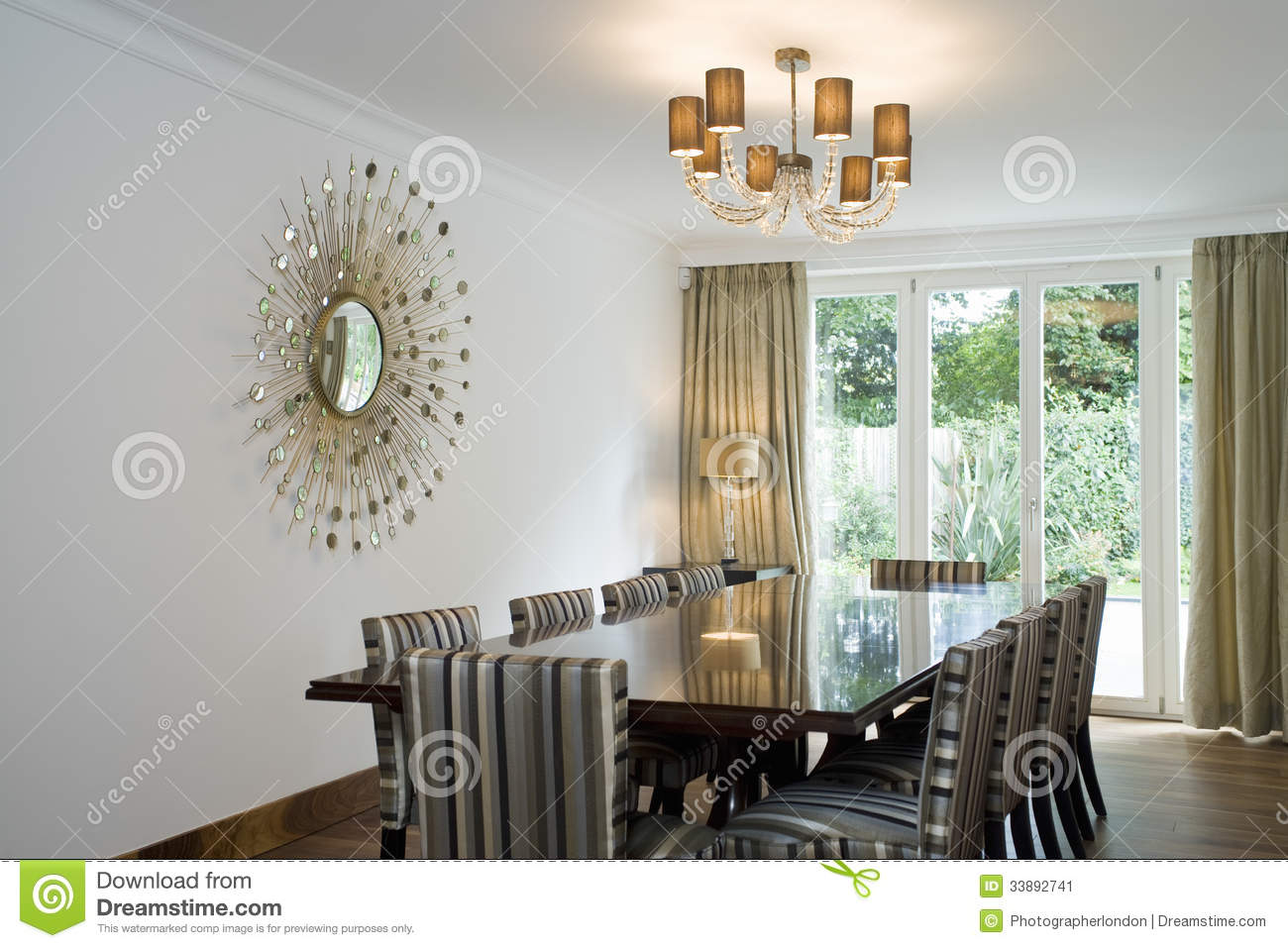 Chandelier Over Dining Table And Art On Wall Stock Image