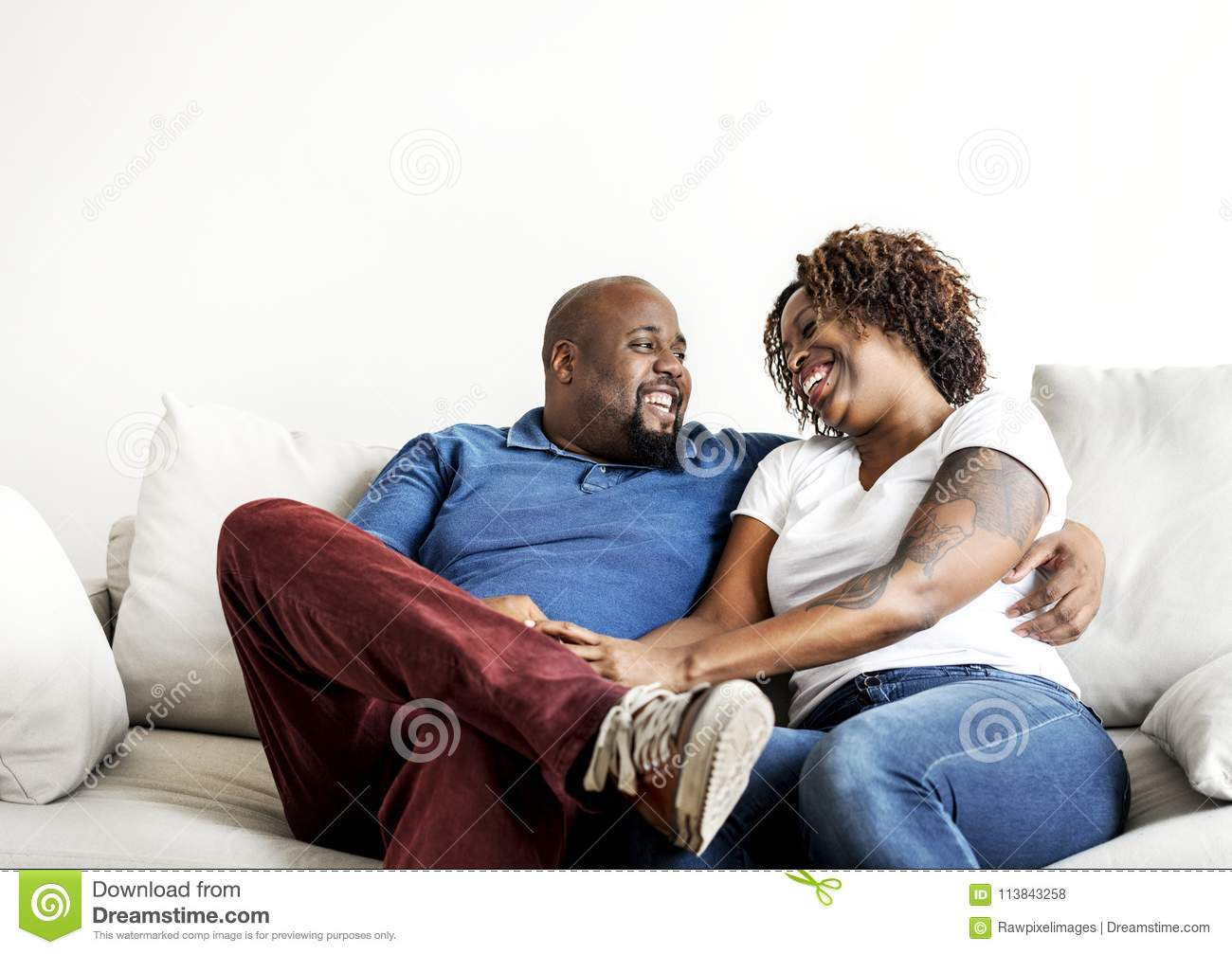 A Cheerful Black Couple Having A Good Time Together
