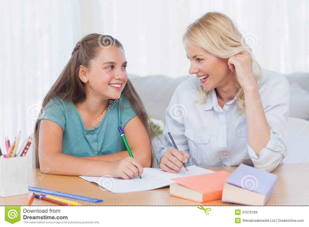 Cheerful Mother And Daughter Writing Together Stock Image