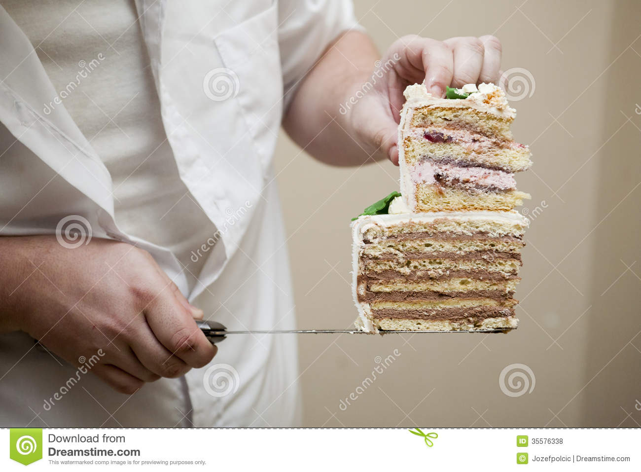 Chef holding cake cuttings stock photo  Image of delicious   35576338 Nice wedding cake with cream and flower decorations  Chocolate and  strawberry filling