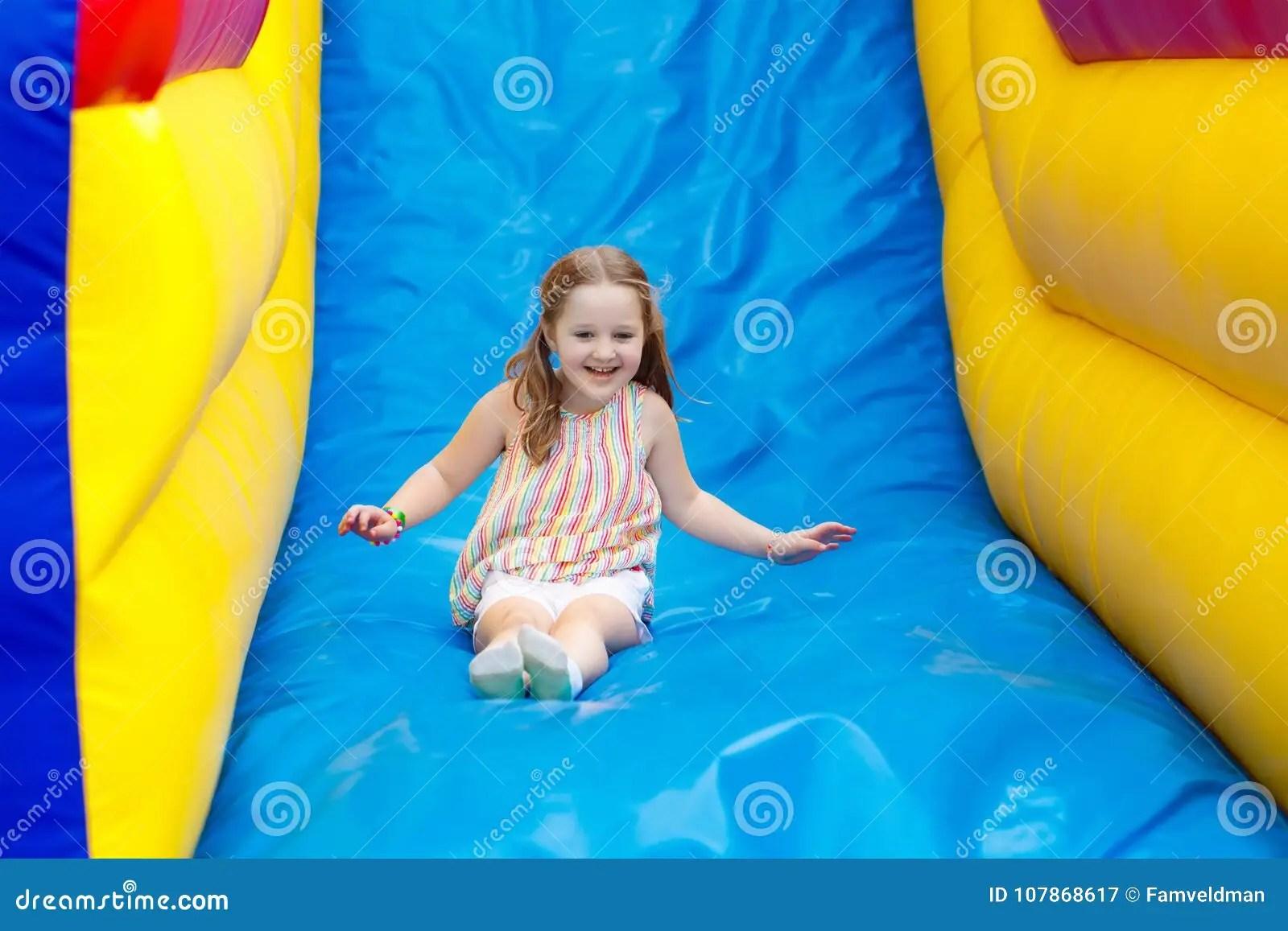 Child Jumping On Playground Trampoline Kids Jump Stock Image