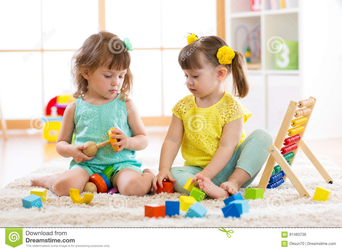 Children Playing Together With Building Blocks