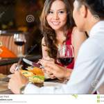 Chinese Couple Having Romantic Dinner In Fancy Restaurant Stock Image Image Of Rendezvous Glass 37544545