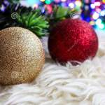 Christmas Lights And Red And Gold Christmas Tree Decorations On A White Fur Carpet Glitter And Sparkle During The Holidays Stock Photo Image Of Bells Gold 165164798