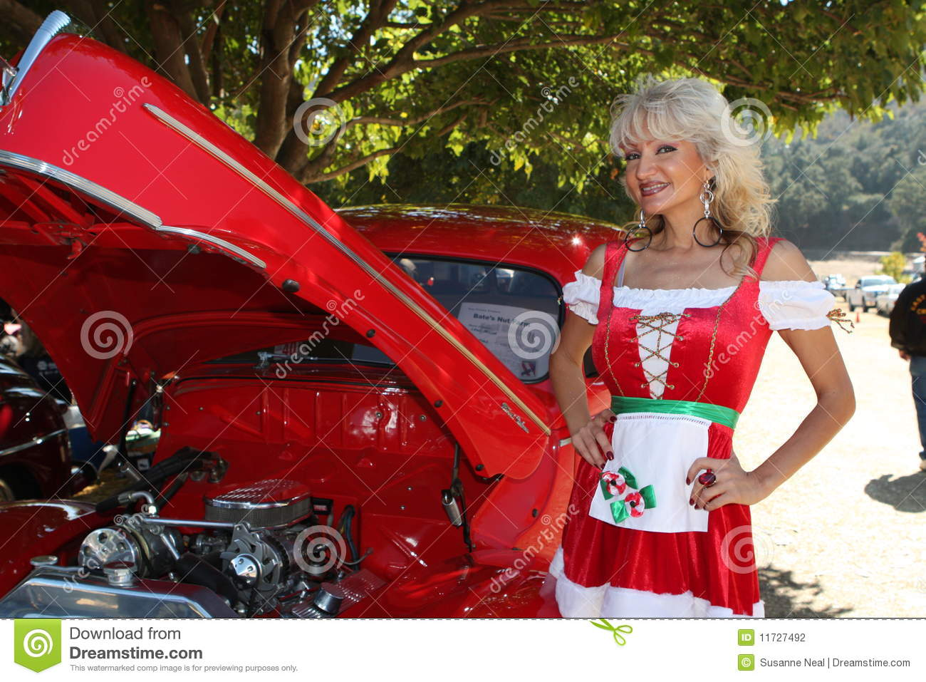 Classic Car And Christmas Dirndl Woman Stock Photography