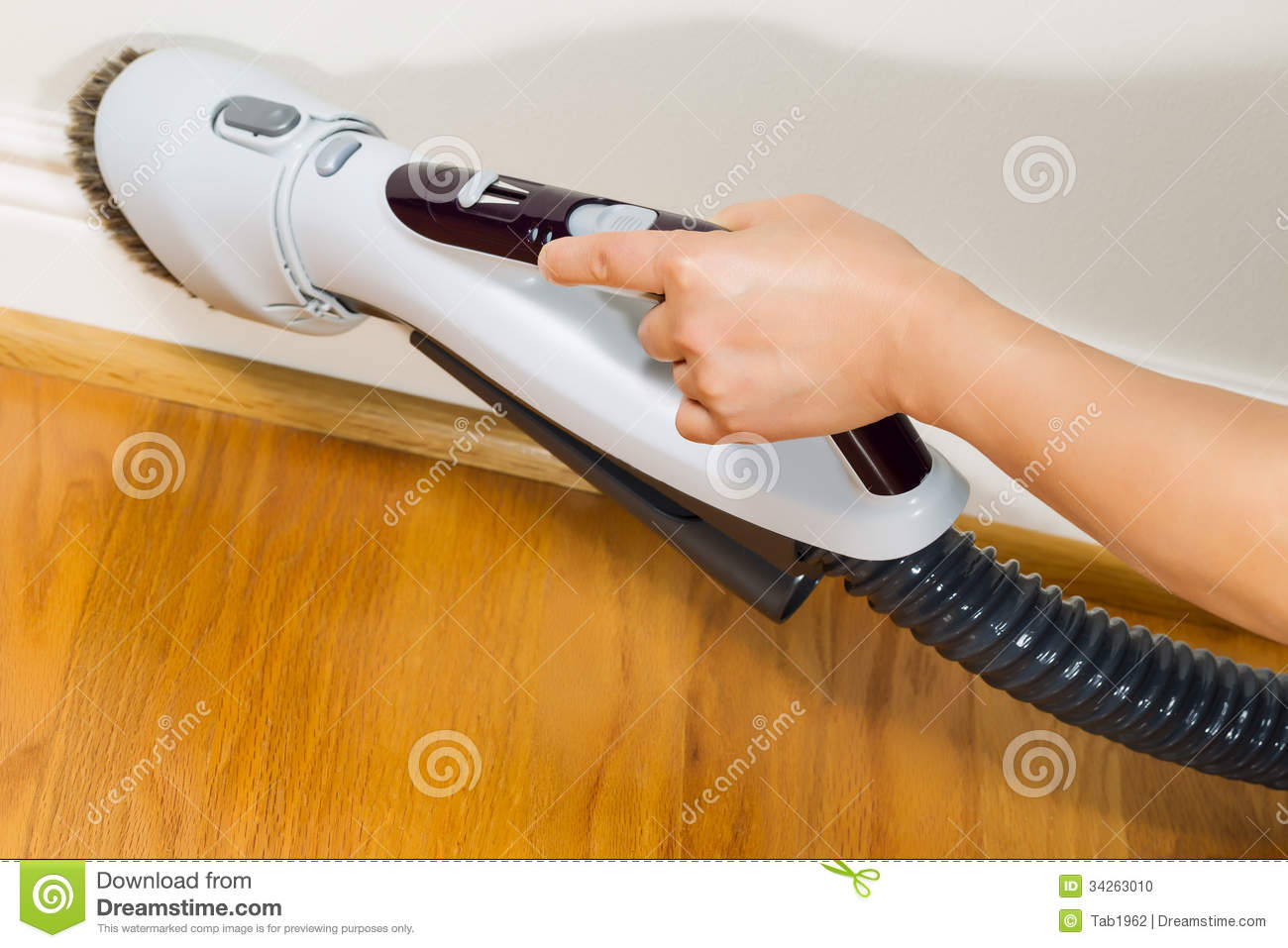 Cleaning Trim Next To Wooden Floors Stock Photo Image