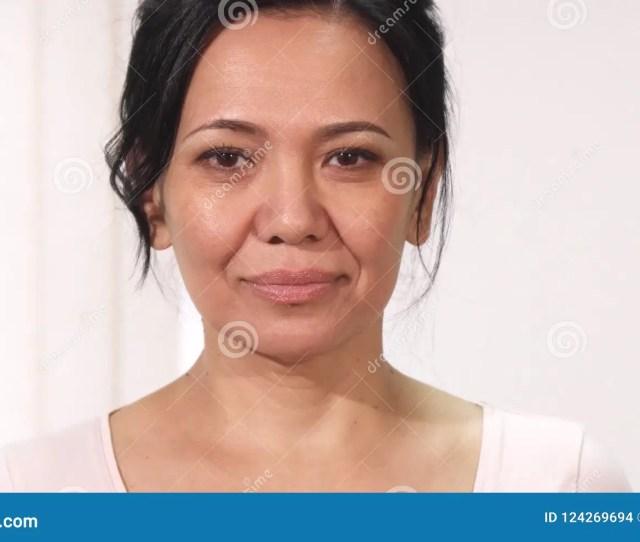Close Up Of A Beautiful Mature Asian Woman Wih Pink Ribbon Breast Cancer Awareness Sign