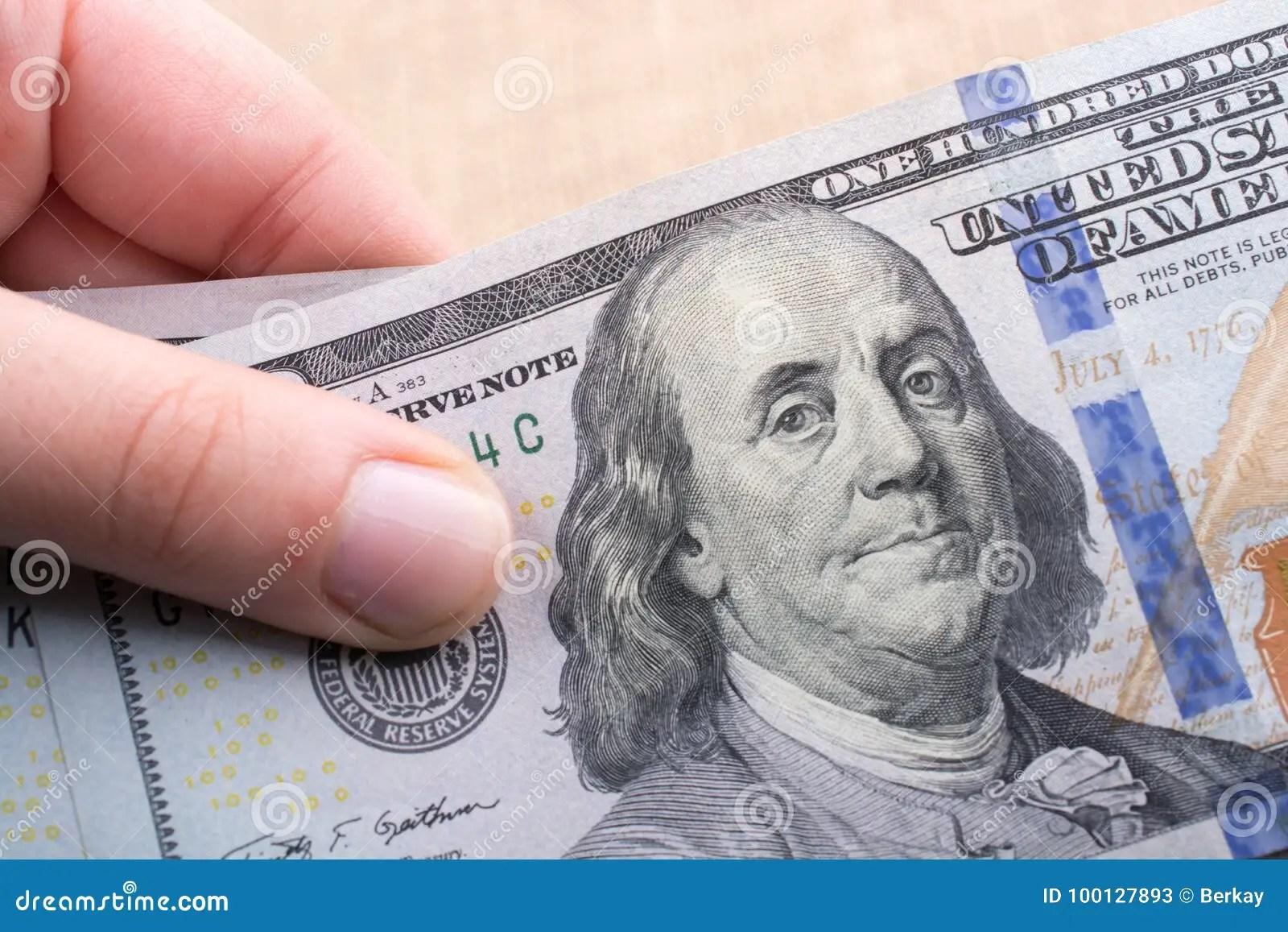 Close Up Of Benjamin Franklin Face On Us Dollar Stock