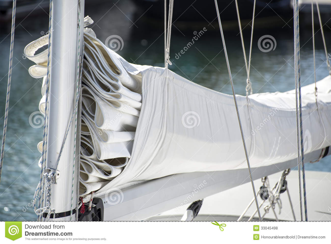 Close Up Image Of Sail And Mast Pulley Systm On Yacht