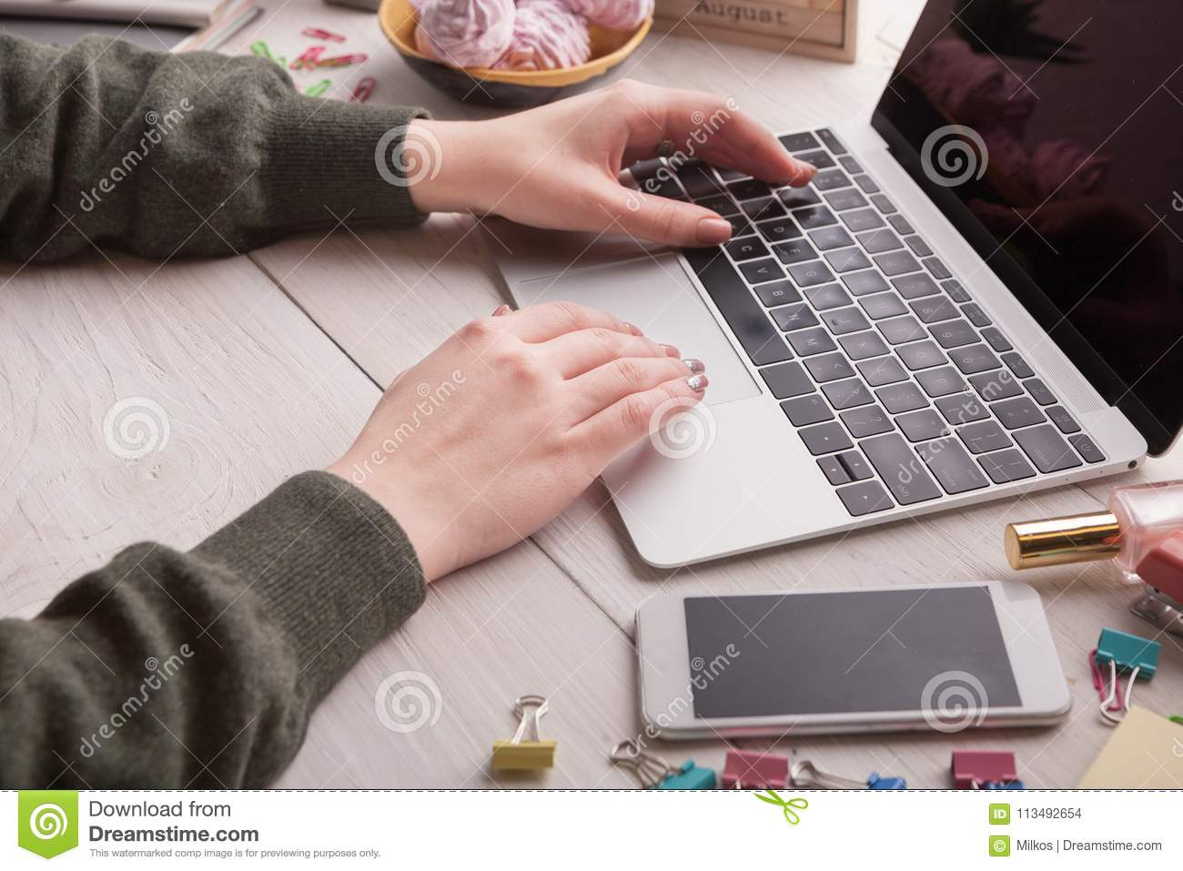 Closeup Of Female Hands Typing On Laptop Keyboard Stock