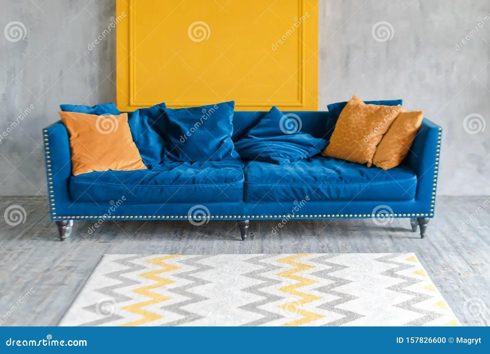 https www dreamstime com comfortable classic blue couch orange pillows simple minimalist apartment comfortable classic blue couch orange image157826600