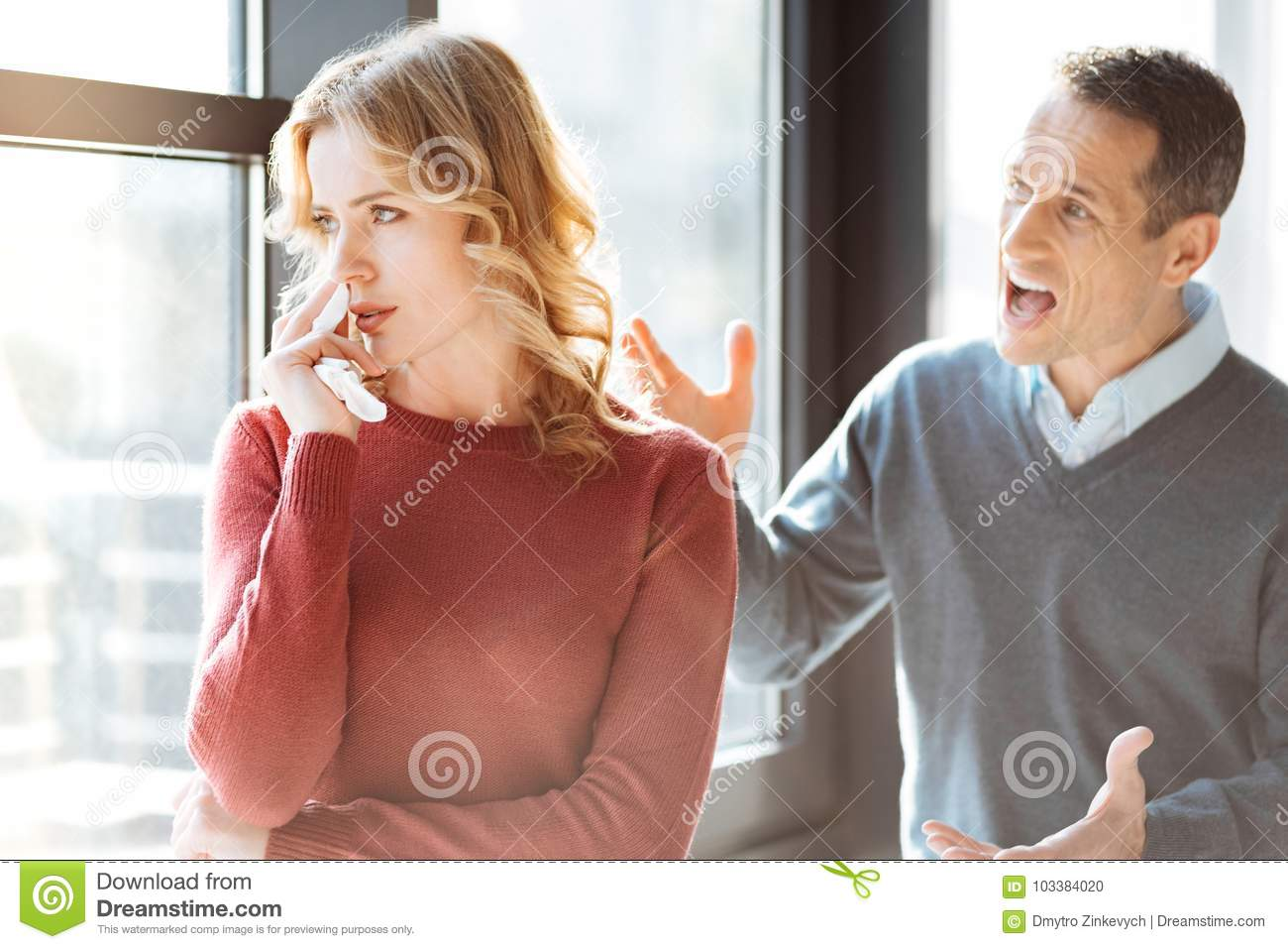 Angry Emotional Man Shouting At His Wife Stock Photo