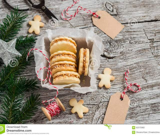 Cookies With Caramel Cream And Walnuts In A Vintage Metal Box Christmas Decoration And A