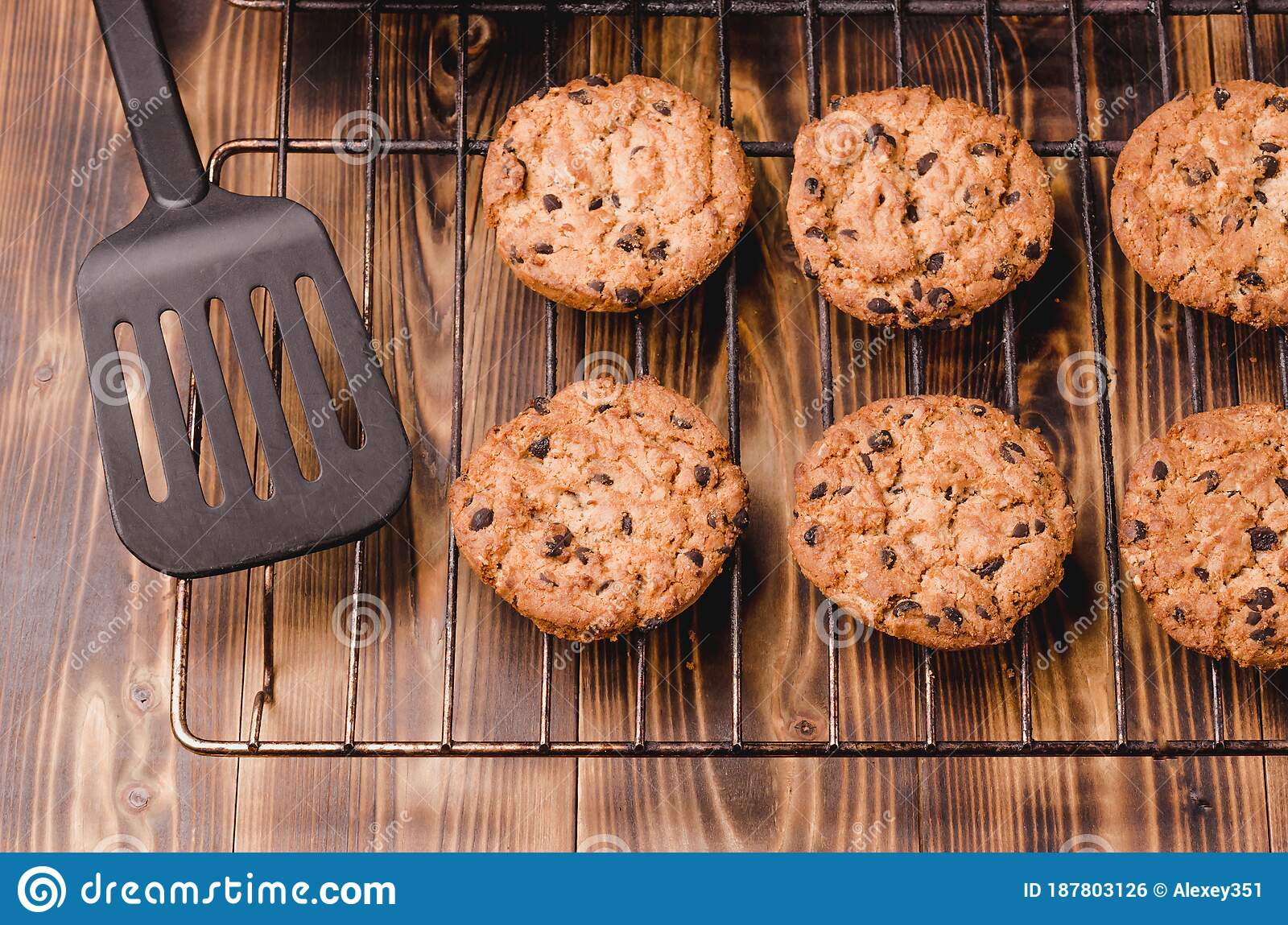 cooling rack with chocolate chip cookies cooling rack with chocolate chip cookies on wooden background top view stock photo image of tasty biscuits 187803126