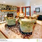 Cozy Big Living Room With Rock Background Fireplace Stock