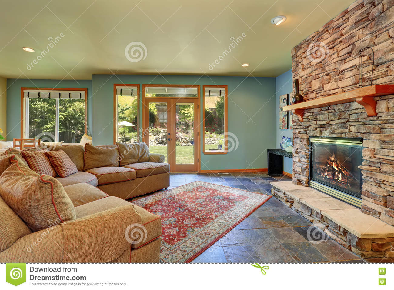 cozy living room with blue walls and stone tile fireplace stock photo image of bright home 75603616