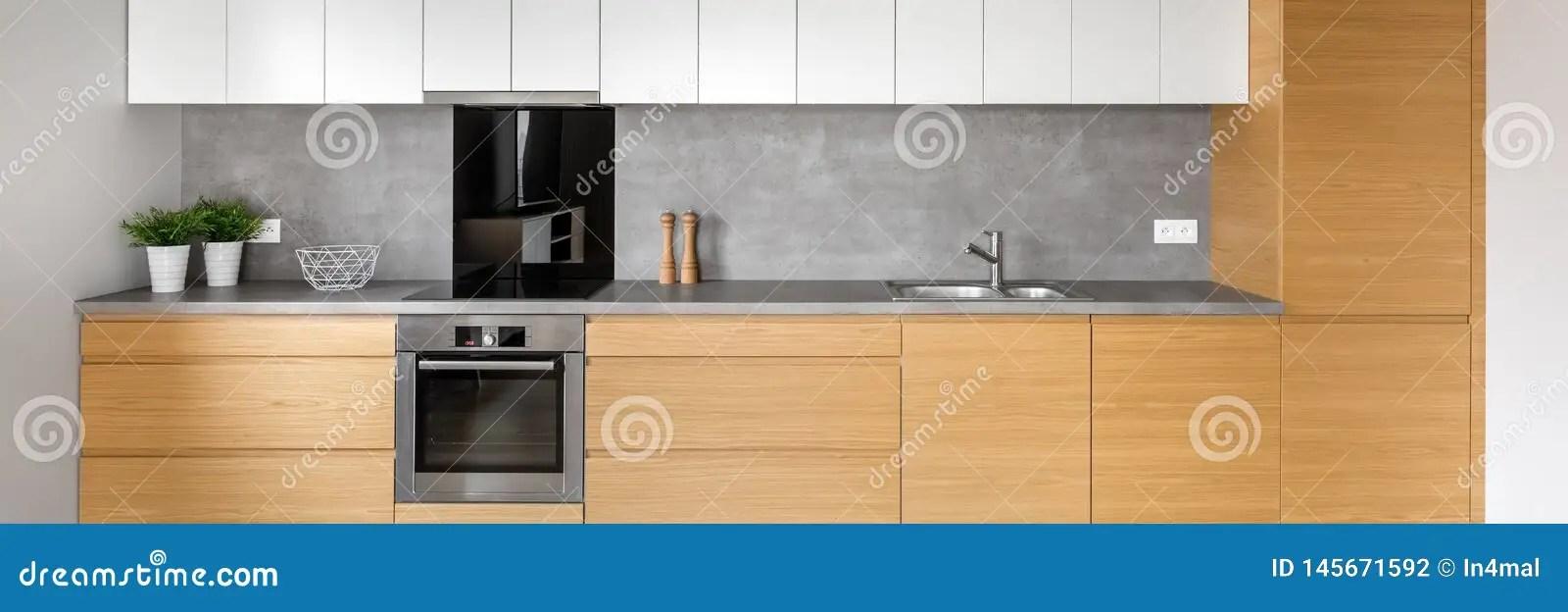https fr dreamstime com cuisine carrelage gris panorama moderne les armoires brunes blanches grises plan travail granit image145671592