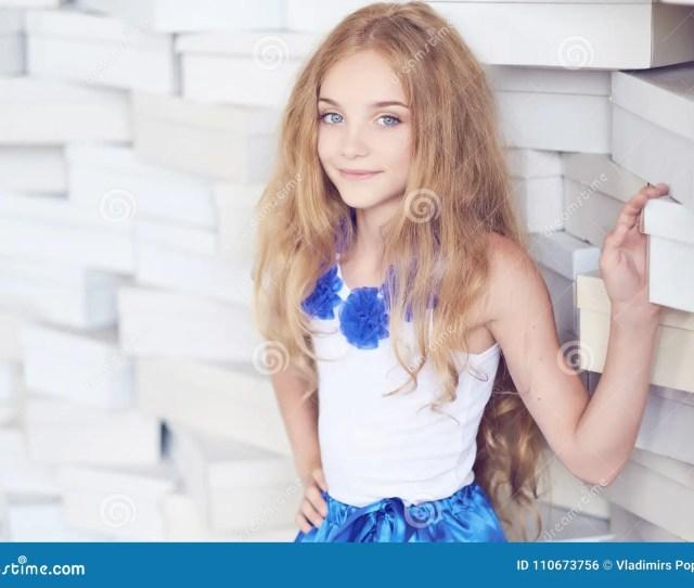 Cute Blond Teenager Female In A Blue Skirt