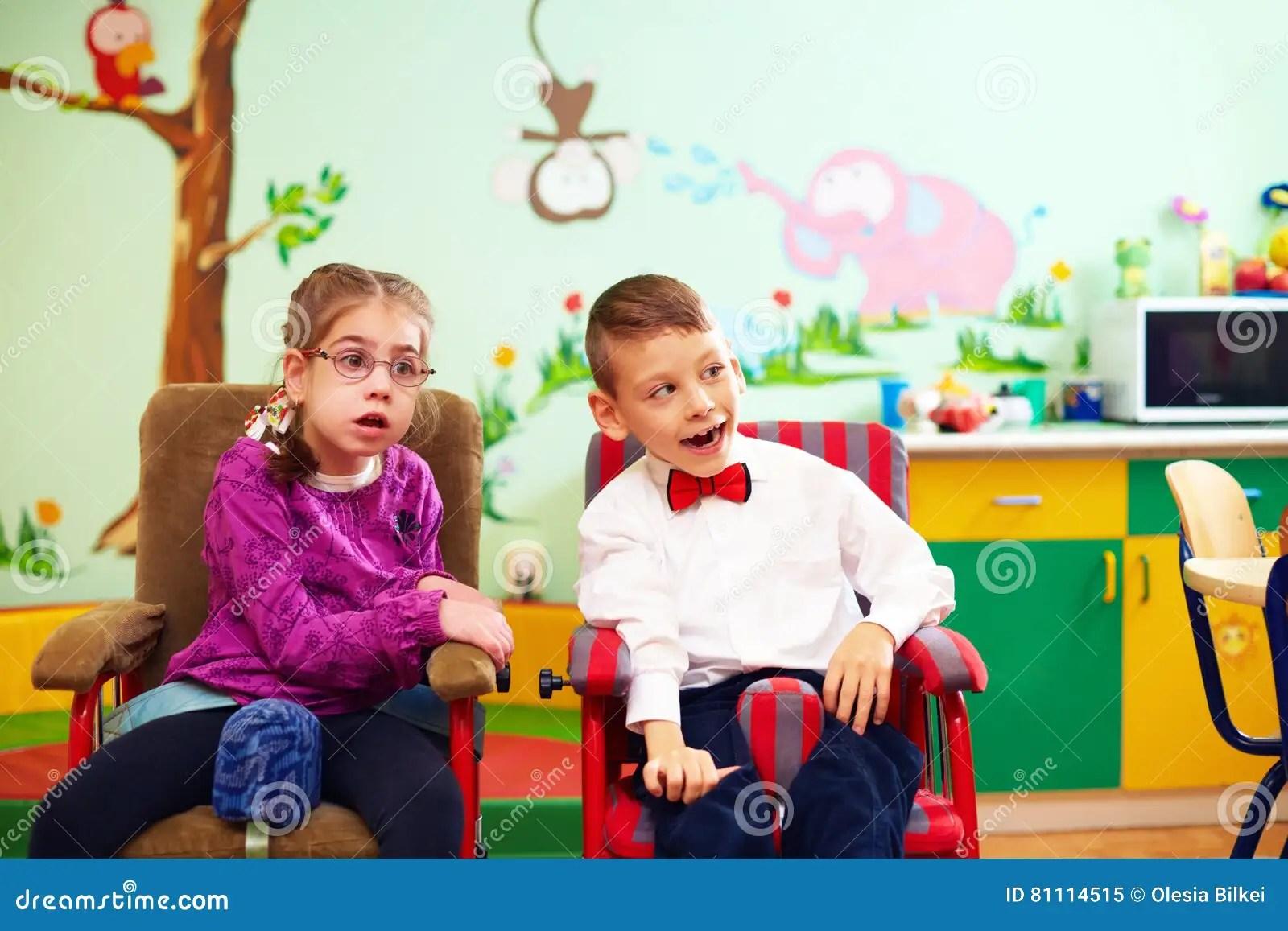 Cute Kids In Wheelchairs At Kindergarten For Children With