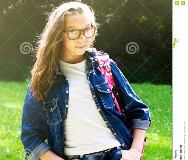 Cute Young Blonde Schoolgirl With Glasses And Denim Shirt