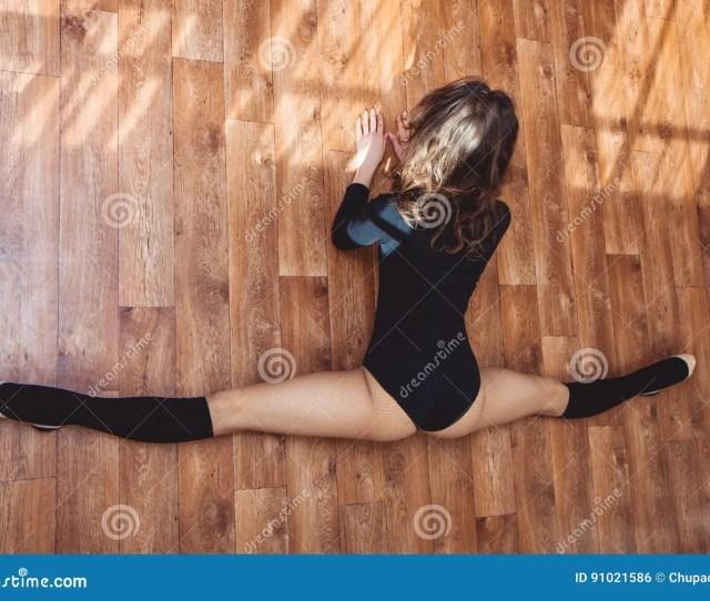 Dancer Girl Doing Stretching Exercise For Legs