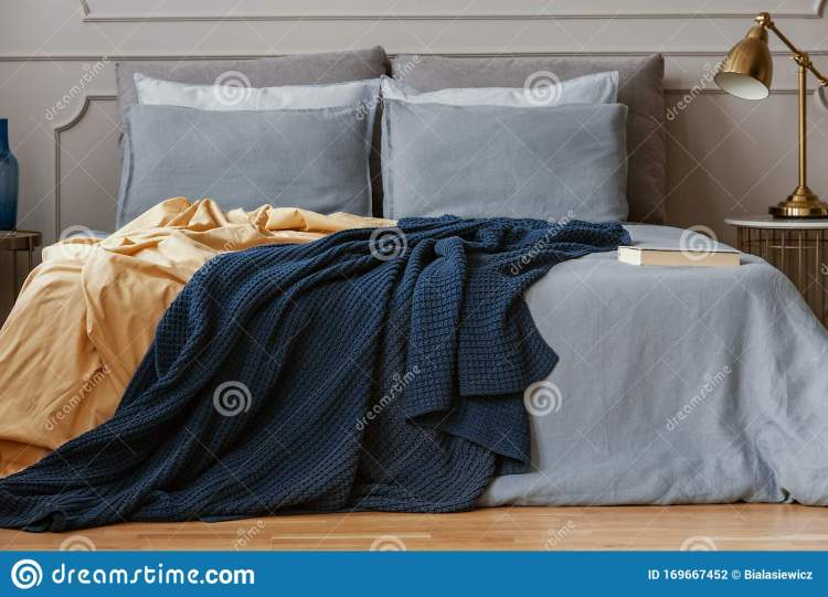 Dark Blue And Orange Blankets On Comfortable Double Bed In Grey Stylish Bedroom Stock Photo Image Of Home Chic 169667452