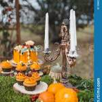 Decor For Halloween Pumpkin Cake Cupcakes Candle Holder With Candles And A Table Of Moss Stock Photo Image Of Table Candle 199622184