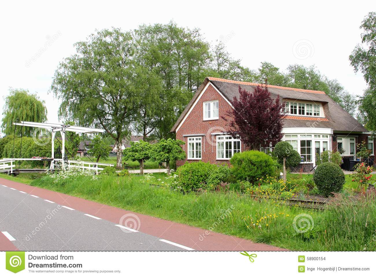 Dutch Country House With A Garden Canal And A Draw Bridge