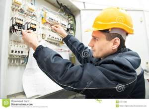 Electrician With Drawing At Power Line Box Royalty Free Stock Image  Image: 24017356