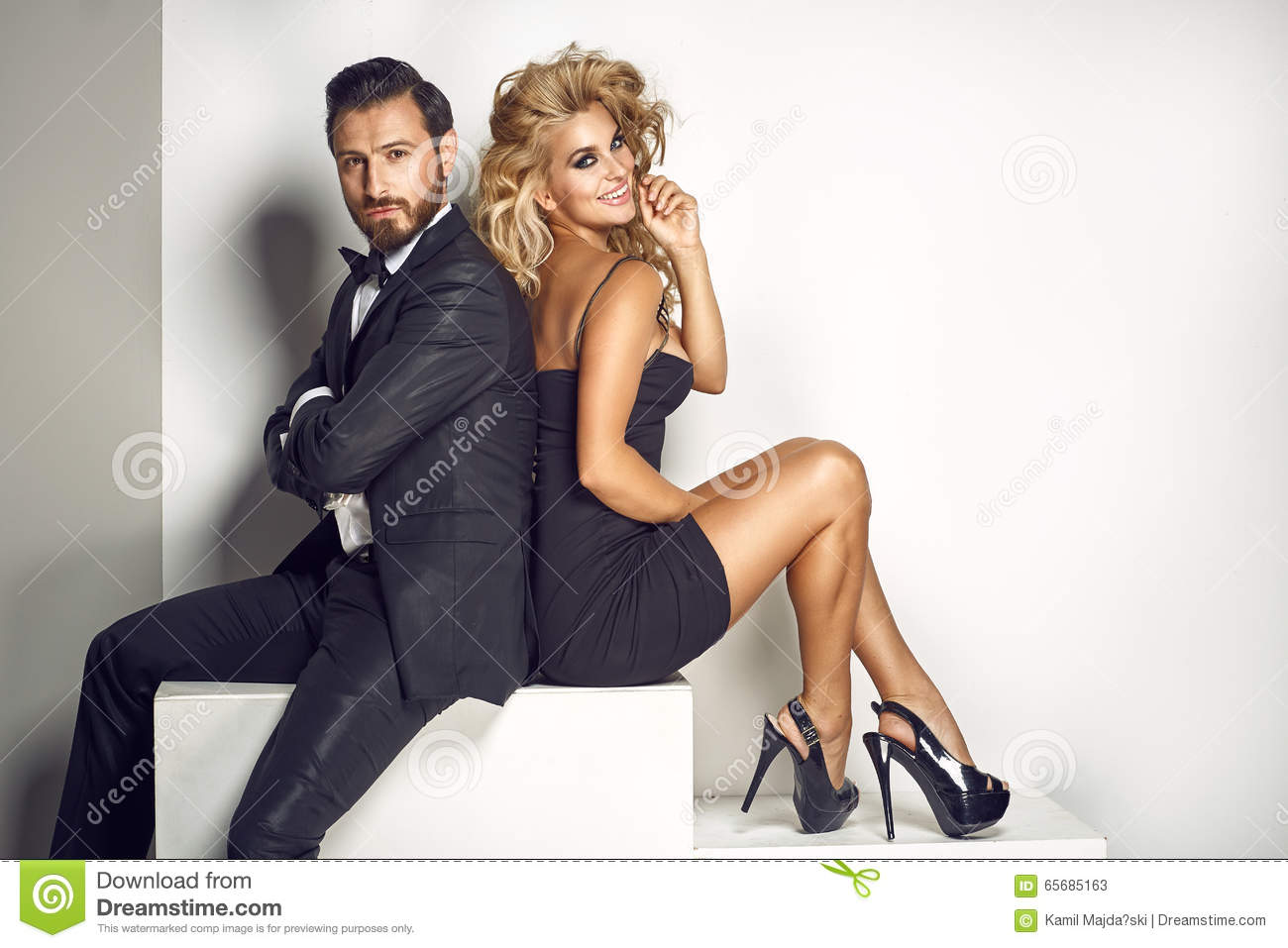 Elegant Couple Looking At The Camera Stock Image Image
