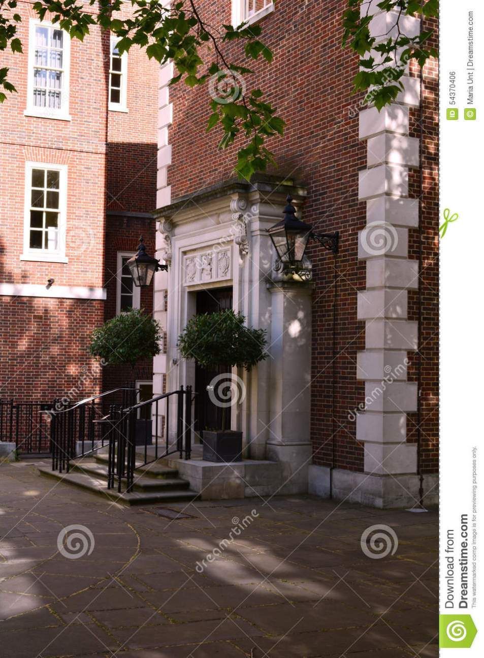 Elegant Red Brick Building Entrance With Stairs Nea