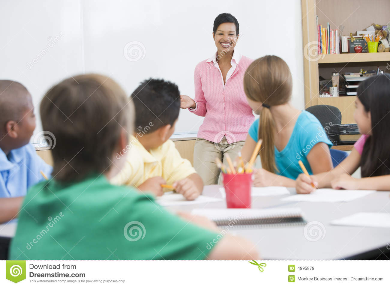 Elementary School Classroom With Teacher Royalty Free