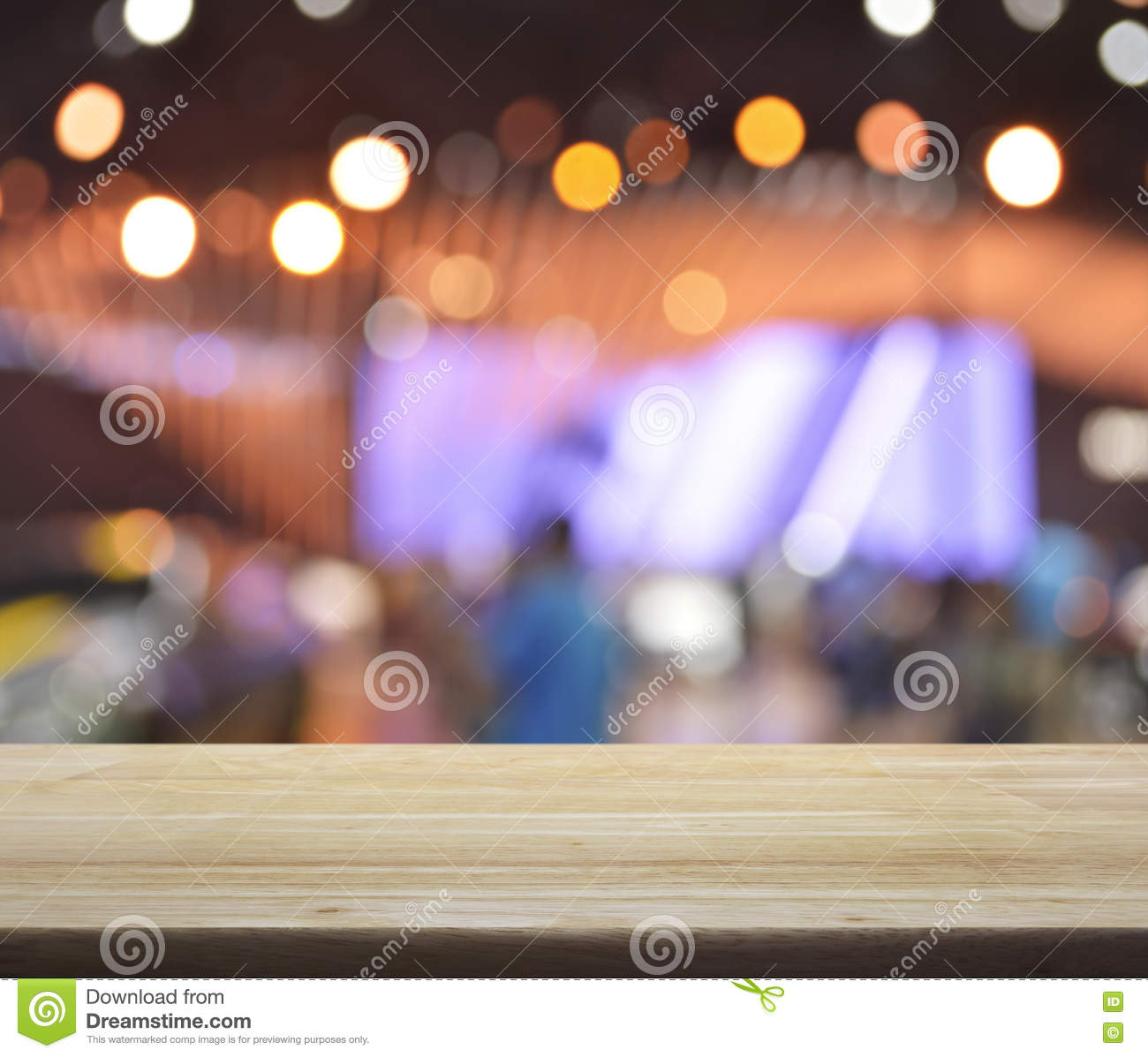 Empty Top Of Wooden Table With Blur Shopping Mall