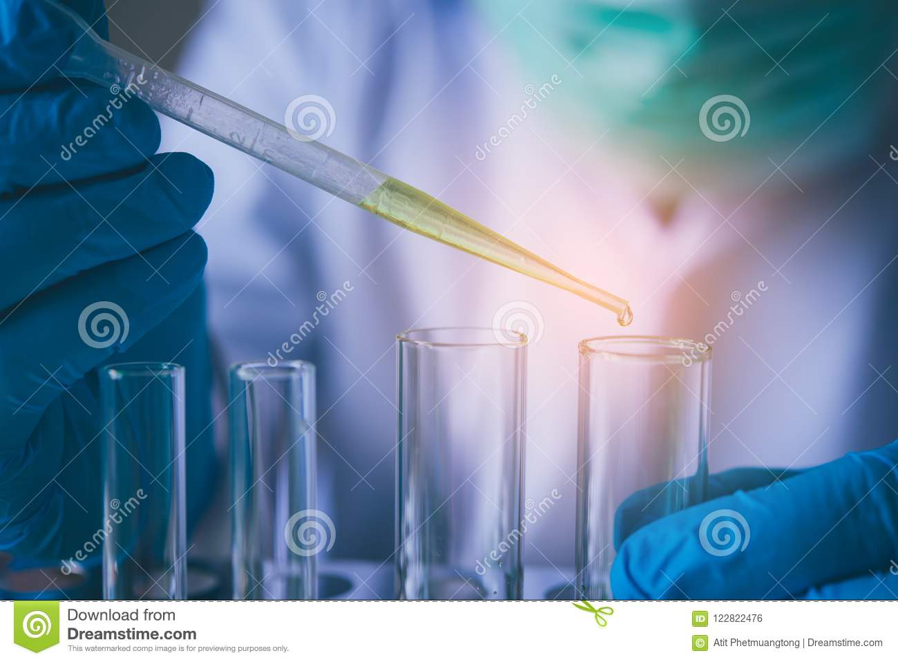Equipment And Science Experiments Oil Pouring Scientist With Test Tube Green Making Research In