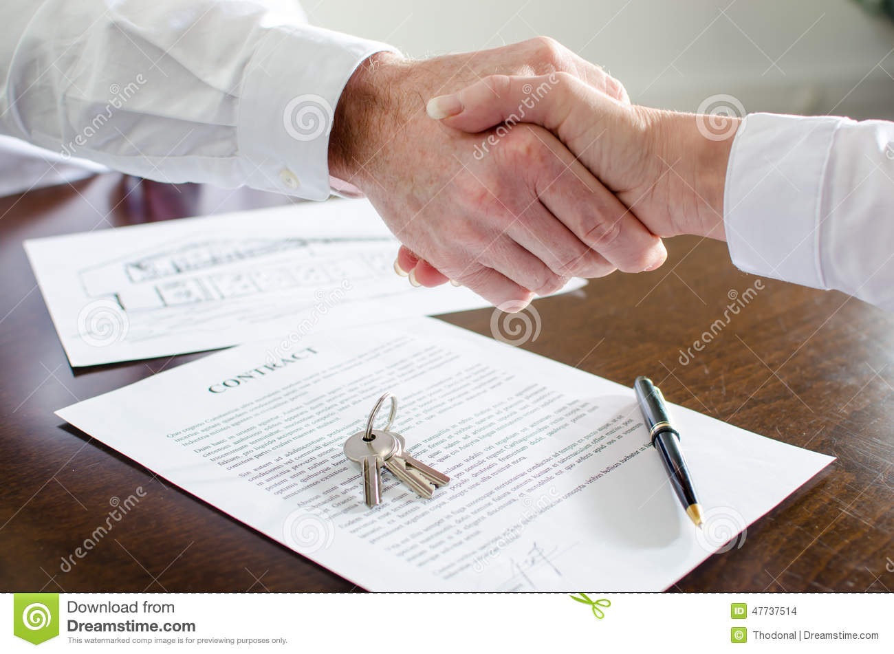 Estate Agent Shaking Hands With His Customer Stock Photo