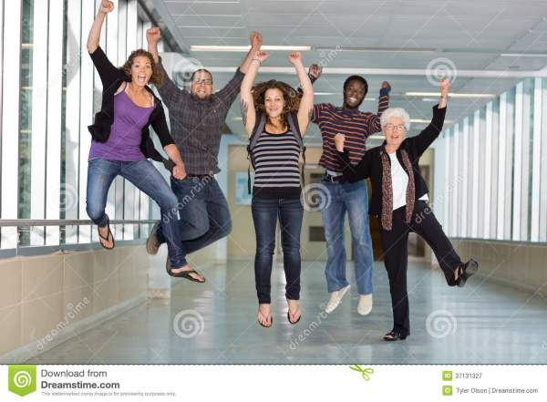 Excited Multiethnic University Students Jumping Stock ...