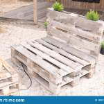 Exterior Benches Made From Old Wooden Storage Pallets On Sand Beach Bar Stock Photo Image Of Sand Chair 148513518
